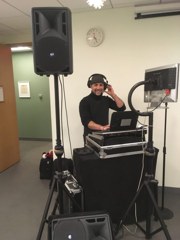 full frontal of DJ Alberto and his dj and karaoke equipment